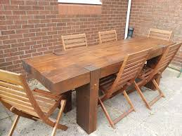 solid wooden sleeper outside or inside table and chairs garden