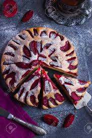 Rustic Plum Cake On Dark Background Top View Stock Photo