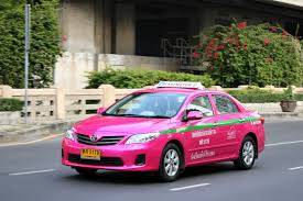 Bangkok brightly coloured taxi Toyota Corolla Altis