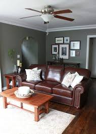 Brown Couch Living Room Colors by Love This Leather Sofa That Will Mix In The Warm Colors That You