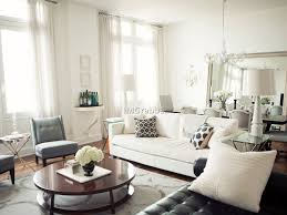 Cute Living Room Ideas On A Budget by Office 42 On The Wall Beside Round Mirror Above Sofa Striped