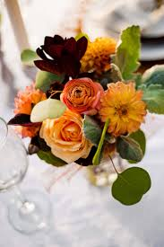 Fall centerpiece in shades of orange with rose and dahlias stunning