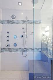 subway tile shower with accent