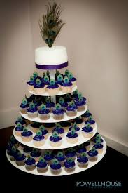 Peacock Wedding Cake with Buttercream Rosettes and Gold Dragees by