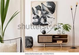 skandinavisches und design wohnzimmer mit holzkommode