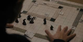 Eleven Looks At The Board Still Arranged For Troglodyte Demogorgon Battle