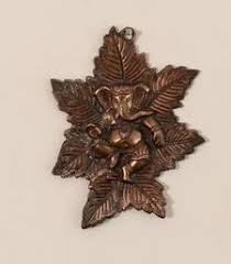 Buy Metal Wall Hanging Of Lord Ganesha On Maple Leaf Housewarming Gift Online Small 1d44ff3f4d093069d56e7327eedc29da60f5c0cc09300f652d7f464c9cb4e123