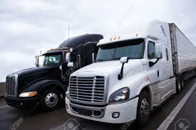 Two Contrasting Shiny Modern Black And White Big Rigs Semi Trucks ...