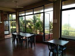 Nakshatra Beach Resort By ONest Entrance To Dining Area And Door Balcony