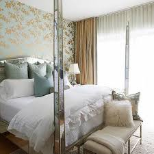 Antiqued Mirrored 4 Poster Bed With Blue Pillows