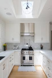 2 white kitchens with contemporary pendant lighting