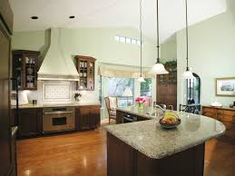 Kitchen Sleek Design Idea With High Ceiling Also Brown Cabinetry Granite Top L Shaped Island Room Amazing Mondeas Layout For Small Space Seating