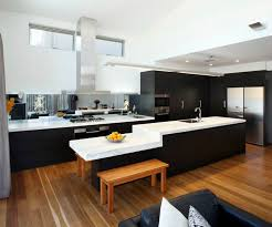 Amazing Black Scheme Modern Kitchen Design White Island Surface And Sofa Seat On Wooden Flooring