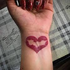 Batman Symbol In Wrist Tattoo For Female