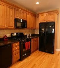 Kitchen With Oak Cabinets Black Appliances