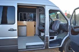 DIY Sprinter Camper Van Interior Showing Swiveling Front Seats Photo 3Up Adventures