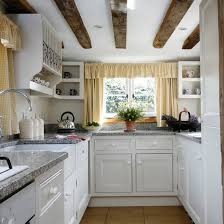 Small Kitchen With Exposed Beams Granite Worktops White Cabinetry Open Shelving Plate