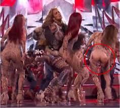 Jennifer Lopez baking dancer suffers wardrobe malfunction at AMAS