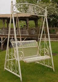 Beautiful And Ornate Cream Outdoor Swing