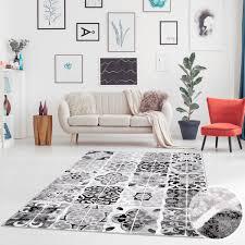 teppich flachgewebe flachflor modern patchwork ornamenten florale verzierungen schwarz weiß grau wohnzimmer