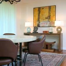 Eclectic Dining Room With Leather Chairs And Oriental Rug