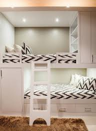 contemporary bunk room features white built in bunk beds with top