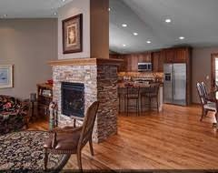 fireplace in middle of living dining room kitchen family room