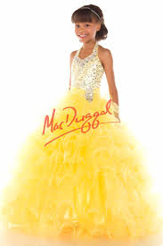 girls yellow dresses and gowns everythingformals com