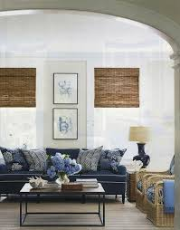 Elegant Beachy Cottage Living Room Design With Soft Sand Walls Paint Color Bamboo Roman Shades