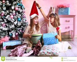 Download Teenager Girls With Christmas Tree And Presents Stock Image