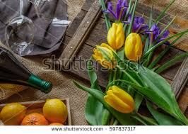Easter Card In Rustic Style With Yellow Tulips Spring Iris Bottle Of White Wine