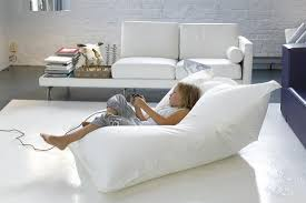 Good White Living Room Decoration Using Extra Large Bean Bag Chairs For Adults Including Leather Sofa And Brick Wall