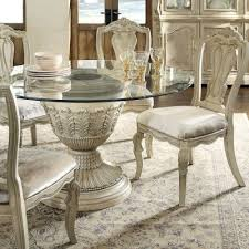 ortanique round pedestal dining table signature design by ashley