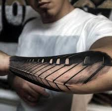 Cool Piano Keys Forearm Tattoo For Men With Realistic Design