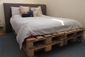 country wood pallet platform bed with headboard and side table