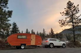 A Timberline Camper Trailer Attached To An SUV