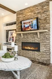 A stacked stone wall accented by Heat & Glo s 42 inch Cosmo gas