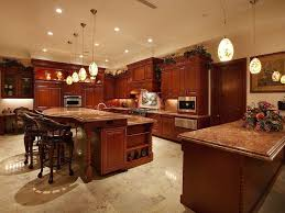 Rich Red Wood Over Beige Marble Flooring Throughout This Kitchen Large Two Tiered Island