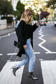 emma hill wears black coat ysl croc tassel monogram bag ripped