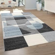 teppich wohnzimmer kurzflor moderne geometrische muster pastell grau weiß blau