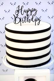 Black and white birthday cake from a chic Party Like a Panda Birthday Party at Kara s