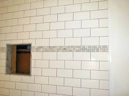 bathroom wall decoration ideas feature white subway tile shower