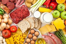 different types of cuisines in the table filled with different types of foods directly above