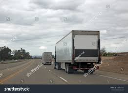 Rear View Interstate Trucking Stock Photo 748816516 - Shutterstock Four Tractor Trailers And A Pickup Were Involved In Fatal Pileup Cy05a Peterbilt Covered Truck Inrstate Trucking Harveys Matchbox How Many Hours Can Texas Driver Drive Day Anderson Sygma Network On 95 Sthbound Youtube Distributor Deploying Omnitracs Fleet Owner Colorado Dirt Delivery Marquez And Son Truckdomeus Reviews Butch Cameron Bulk Liquids Tales From The Big Rigs I20 Truckers Share Experiences Wner Involved In Fatal Inrstate Crash Truckersreportcom Equipment Sales 335 Batteries Route Delivery Truck With Mickey
