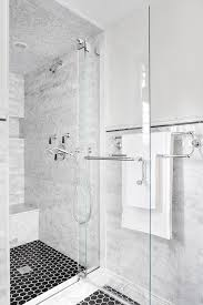 gray subway shower tiles with white marble top bench