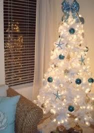 Seashell Christmas Tree Garland by 25 Coastal Christmas Holiday Trees Inspired By The Sea