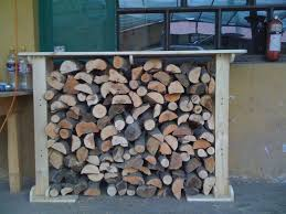 simple diy outdoor firewood storage rack design with table top in
