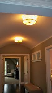 lighting ideas flush mount lights on wooden hallway ceiling for