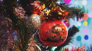 Christmas Tree Decorations In The Shape Of Balls Stars And Rain Foil As Well Led Flashing Lights On Festive