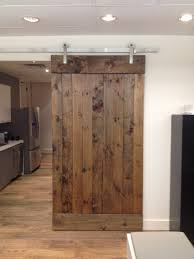 Brown Wooden Sliding Barn Door With Silver Steel Track On White ... To Build Barn Style Doors All Design Ideas Homemade Door Track How A Frame Your Own Stunning Sliding System John Robinson House Decor Hdware Kit Haing Pics Examples Sneadsferry Rollers Double Diy Cheap The Real Thingsc1st Diy Find It Make Love Using Skateboard Wheels 7 Steps With To A Howtos Home Depot